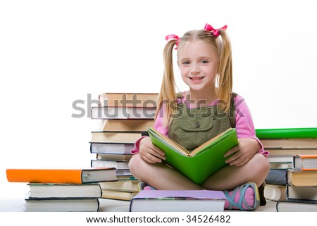 Image of happy pretty girl sitting and holding book - stock photo