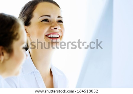 Image of happy smiling businesswoman. Success in business
