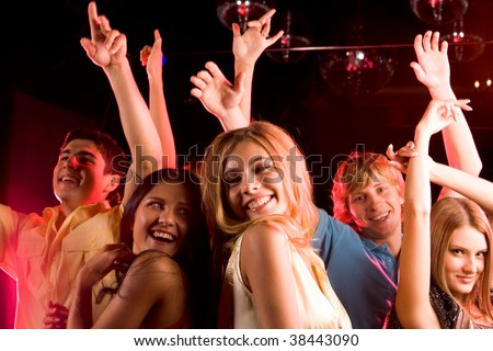 Image of happy young people having fun at disco - stock photo
