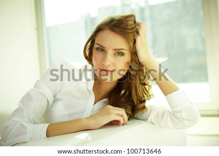 Image of happy young woman looking at camera