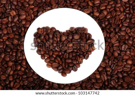 image of heart shaped dark brown coffee beans/Coffee beans
