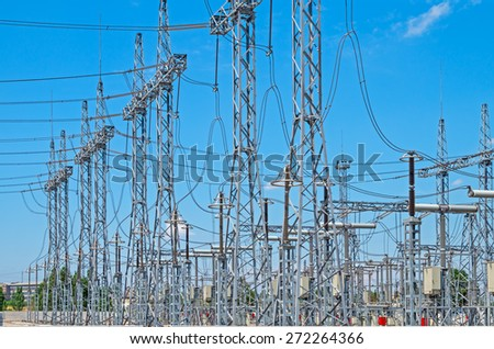 Image of high voltage transformer station against the blue sky - stock photo