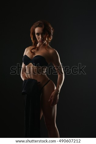 Image of hot red-haired woman posing in lingerie
