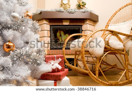 Image of house room with rocking-chair, Christmas tree, fireplace and gifts in it - stock photo