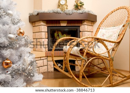 Image of house room with rocking-chair, Christmas tree, fireplace in it - stock photo