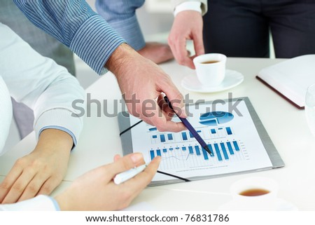 Image of human hand pointing at paper during explanation - stock photo