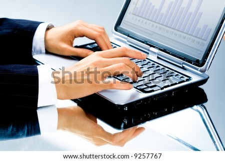 Image of human hand typing a business document on the laptop - stock photo