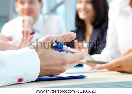 Image of human hand with pen during seminar or conference - stock photo