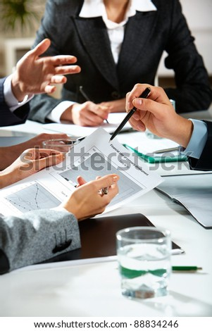 Image of human hands during business discussion - stock photo