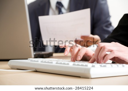 Image of human hands typing on keyboards