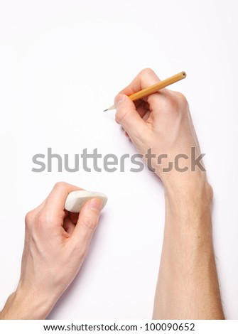 Image of human hands with pencil and eraser on white - stock photo