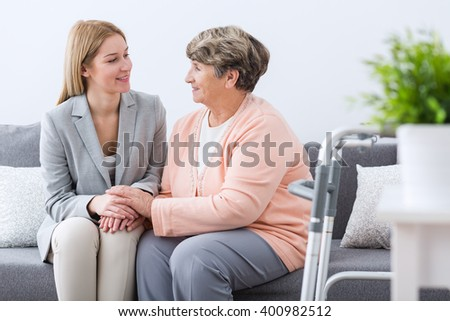 Image of ill senior woman having family support - stock photo