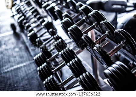 Image of iron dumbbells in two rows - stock photo
