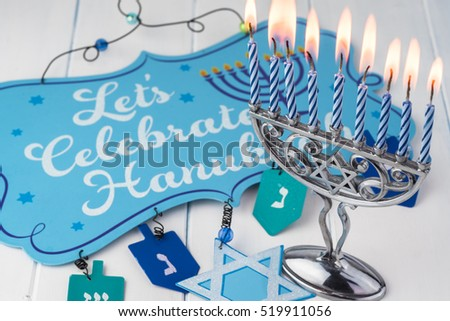 Image of jewish Hanukkah holiday with menorah burning candles.