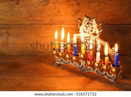Image of jewish holiday Hanukkah background with menorah (traditional candelabra) and Burning candles   - stock photo