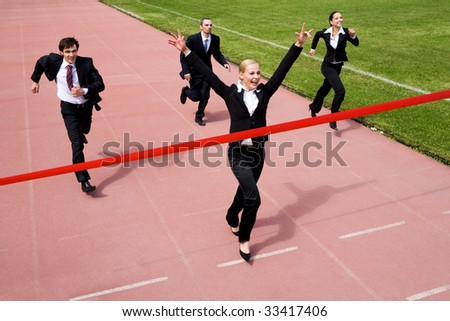 Image of joyful businesswoman winning a business race - stock photo