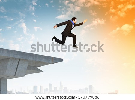 Image of jumping businessman at the edge of bridge - stock photo