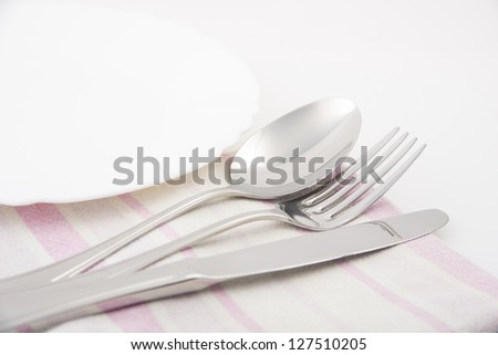 Image of knife, fork and spoon with napkin