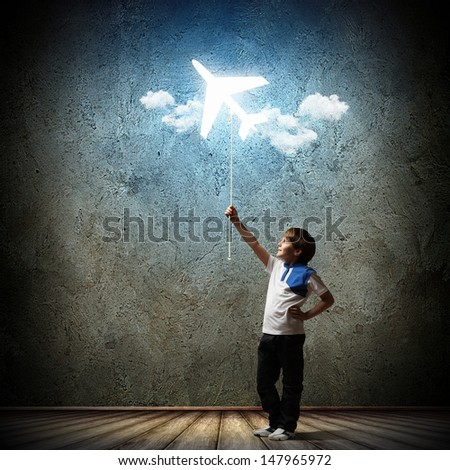Image of little cute boy playing with airplane balloon - stock photo