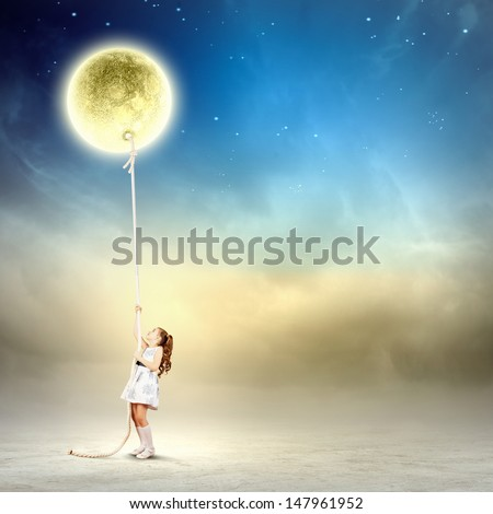 Image of little girl in white dress pulling moon - stock photo