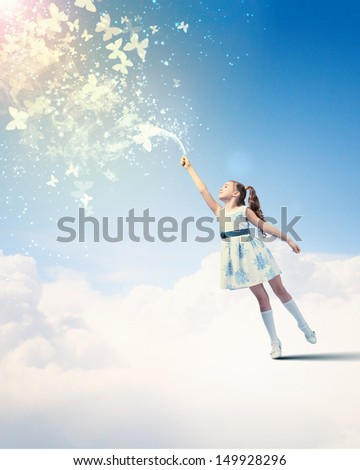 Image of little girl playing with butterflies - stock photo