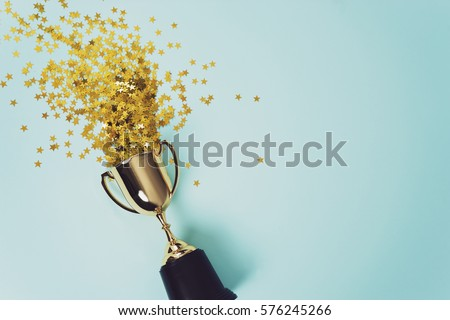 image of little  gold cup , concept for winning or success