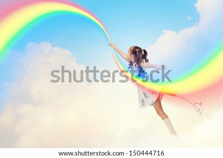 Image of little pretty girl drawing rainbow with finger - stock photo
