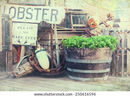 Image of lobster pots, buoys and fishing equipment on the quayside. Bar Harbor, Maine, United States. - stock photo