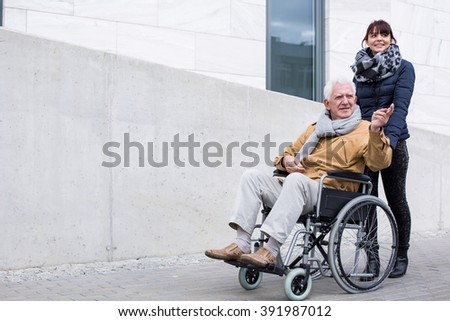 Image of love and support between disabled father and daughter - stock photo
