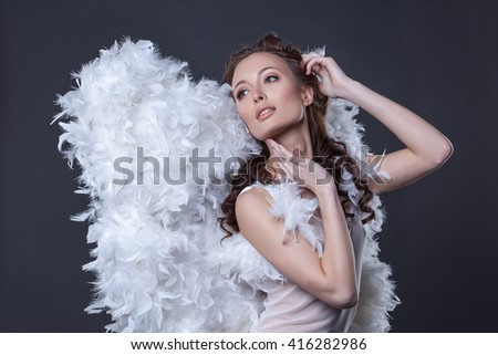 Image of lovely woman in angel costume with wings - stock photo