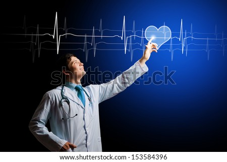 Image of male doctor touching media image