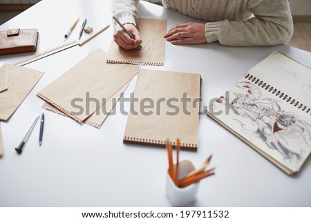 Image of male hands drawing pictures - stock photo
