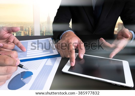 Image of man hand pointing at business document during discussion at meeting, new modern computer and business - stock photo
