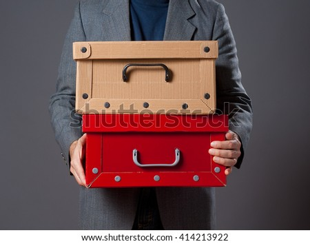Image of man holding  cardboard boxes . - stock photo
