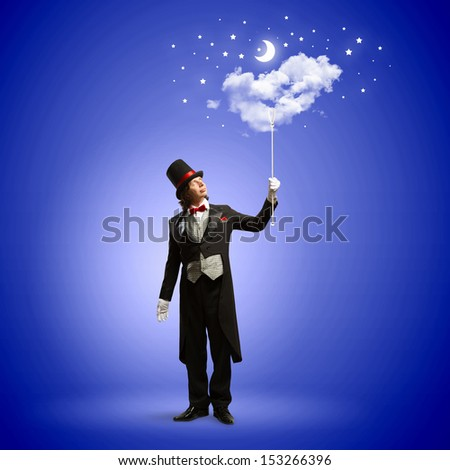Image of man magician against color background - stock photo