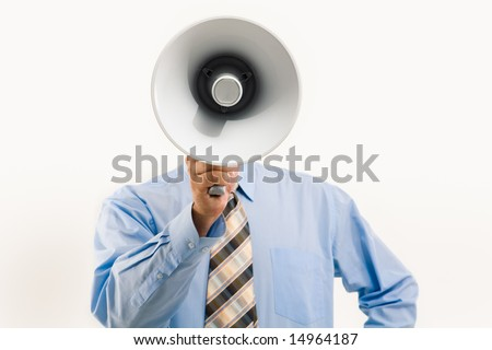 Image of man standing in front of camera and speaking into megaphone - stock photo