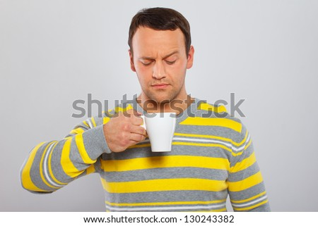 Image of man who is staring on his coffee cup - stock photo