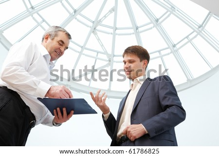 Image of manager explaining their work to boss - stock photo
