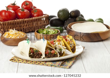 Image of Mexican tacos with vegetables on wooden table - stock photo