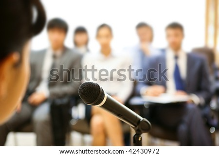 Image of microphone being used by speaker during lecture at conference - stock photo