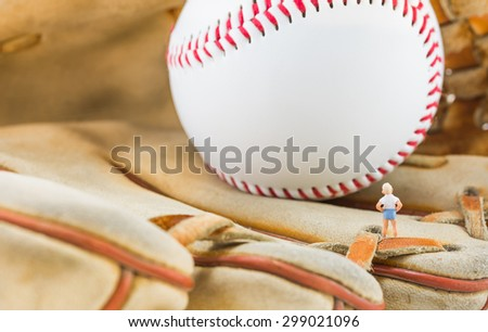 image of mini figure kid dolls with base ball glove and ball