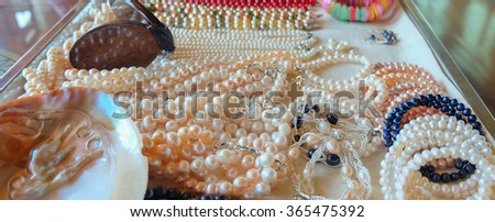 image of mixed abalone jewelry in tray(necklace,earring,bangle,bracelet, bangle, anklet)