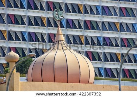 Image of mosque over modern building in Singapore - stock photo