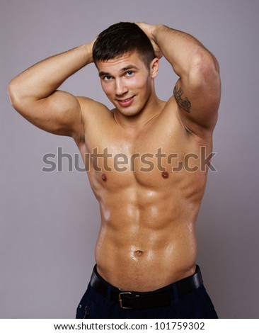 Image of muscle woman posing in studio - stock photo