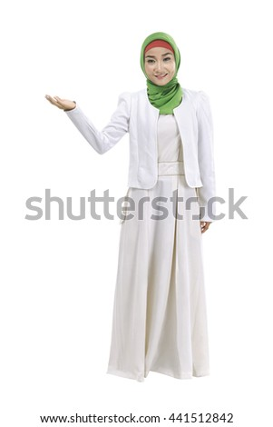 Image of muslim business woman show something isolated over white background - stock photo
