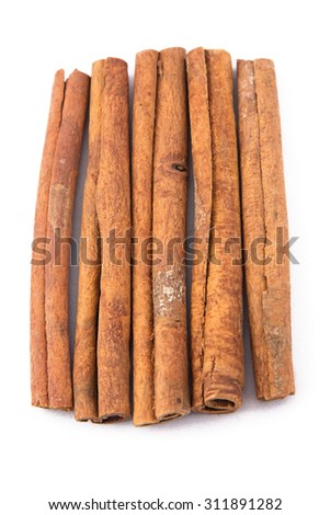 Image of natural brown cinnamon sticks on white background