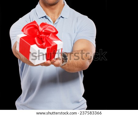 Image of nice guy with a little present - stock photo