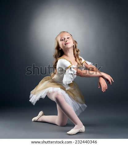 Image of nice little ballerina posing at camera - stock photo
