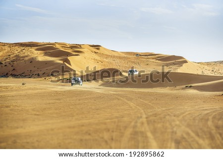 Image of off road cars in the Wahiba desert Oman - stock photo