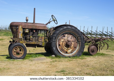Image of Old rusty tractor - stock photo